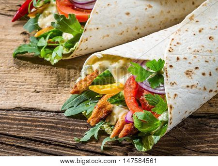 Tasty kebab with vegetables and chicken on wooden background