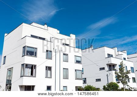 Modern white townhouses seen in Berlin, Germany
