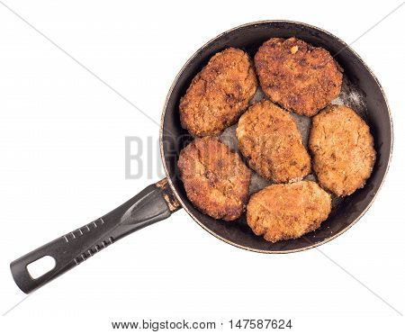 Cooked fried cutlets in pan isolated on white background top view
