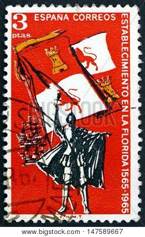 SPAIN - CIRCA 1965: a stamp printed in Spain shows Explorer Royal Flag of Spain and Ships 400th Anniversary of the Settlement of Florida circa 1965