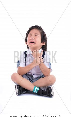 Close up of sadness asian boy sit and crying on white background isolated.