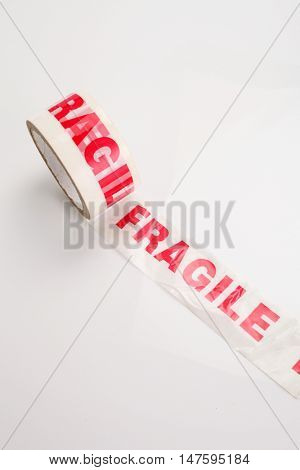 Roll of packing tape on white