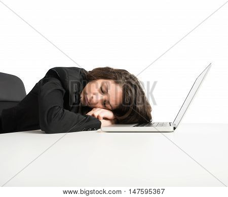 Woman exhausted from overwork sleeping over computer