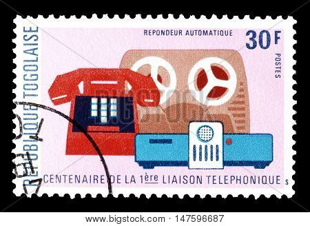 TOGO - CIRCA 1976 : Cancelled postage stamp printed by Togo, that shows Telephone, tape recorder and speaker.