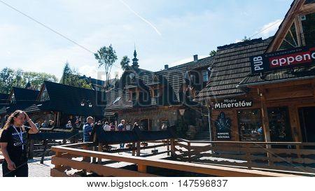 ZAKOPANE, POLAND - AUGUST 29, 2016: Tourists on a popular Krupowki street in Zakopane Poland.