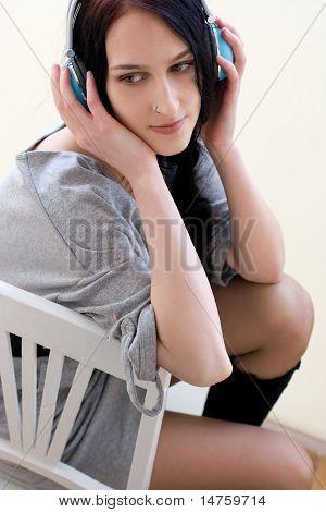 Caucasian Dark Haired Woman With Earphones