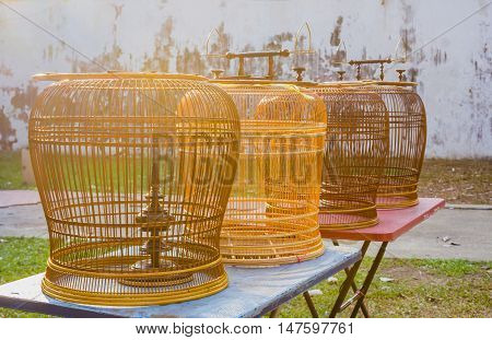 rattan wood bird cages on the tables in sunlight