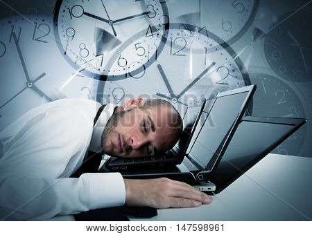 Businessman sleeping on laptop and background with watches