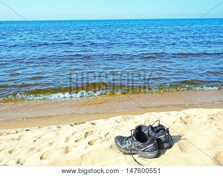 Shoes on the beach on a sunny summer day