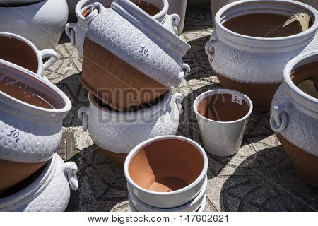 Stoneware, mud vessel handmade in a traditional medieval shop, crafts in Spain
