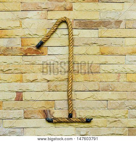 Rope Number one Alphabet on stone background