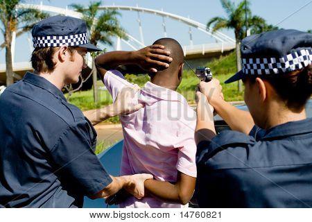 dangerous criminal under arrest at gun point