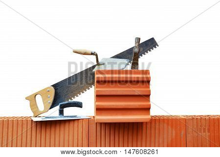 Masonry tools on a brick wall. Bricklaying work.