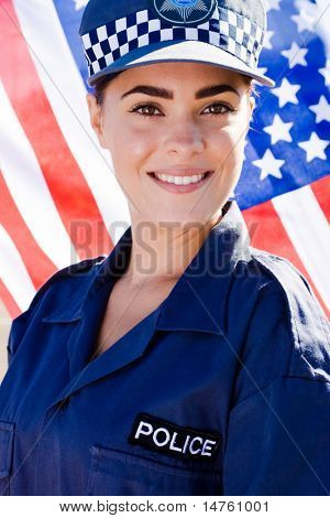 female police officer, background is american flag