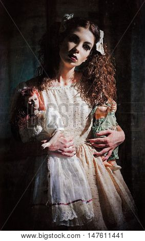 The strange scary girl with toys in hands. Grunge texture effect