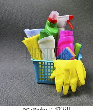 House cleaning product in blue basket.Cleaning equipment.