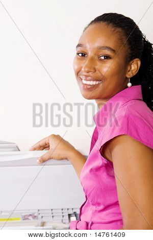 african business woman standing by copy or fax machine