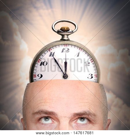 Final countdown. Man with watch or time bomb in his head. Mental illness or terrorism theme.