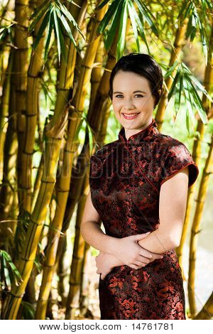 beautiful woman in chinese traditional dress outdoors