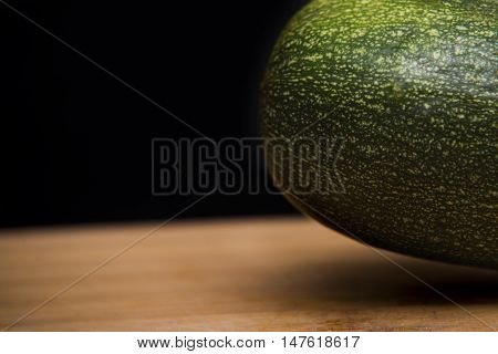 Close Up On Zucchini Courgette On Wood And Black Background