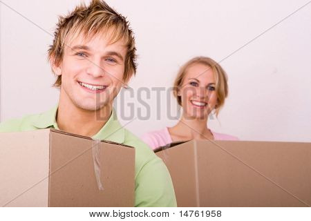 young couple moving in first home