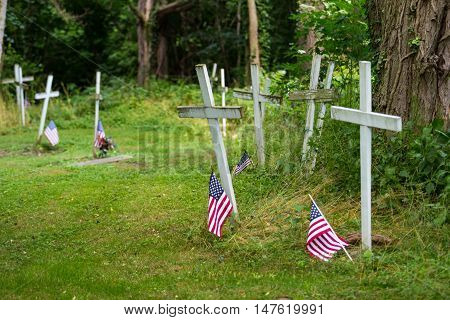 Columbia PA - June 11 2016: Graves in Zion Hill Cemetery marked with wood crosses may be those of some Black Army veterans.