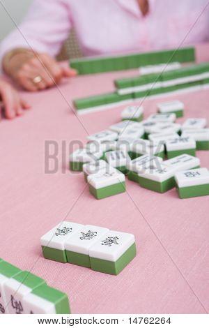 senior woman playing mahjong game