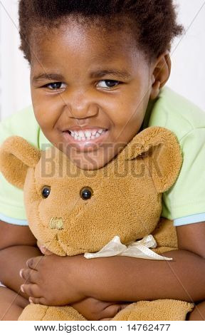 african little girl hugging her teddy bear