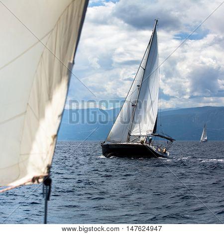 Sailing yachts the participants in regatta in the Aegean sea.