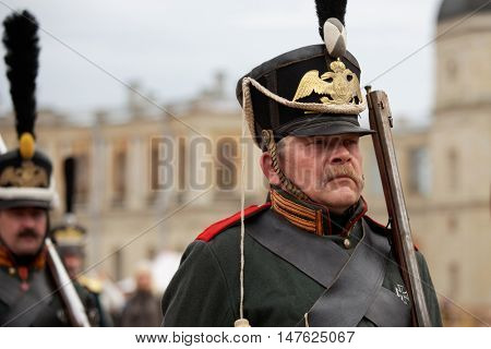 GATCHINA, ST. PETERSBURG, RUSSIA - SEPTEMBER 10, 2016: Soldier in retro uniform of Russian Army in the camp during the festival Gatchinskaya Byl. The festival is held first time this year
