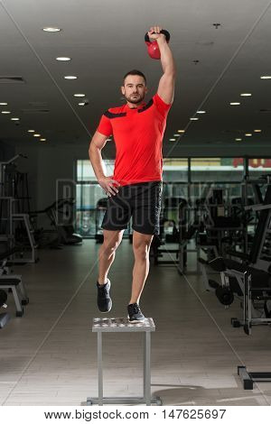 Fitness Instructor Doing Heavy Weight Exercise With Kettle-bell