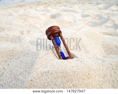 Hourglass on sand beach. Hourglass or Sand Timer measuring the passing time in a countdown to a deadline. Time concept.