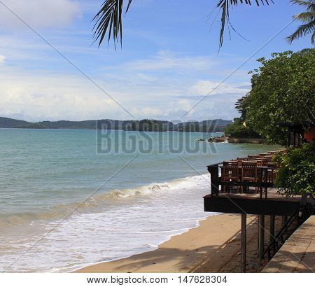 Ao Nung beach, looking out toward the islands, restaurant balcony visible on the right, Thailand