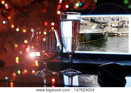 glass of wine and a laptop on a festive background