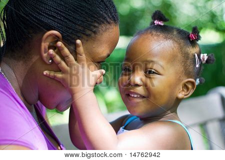 happy african american daughter play with mother