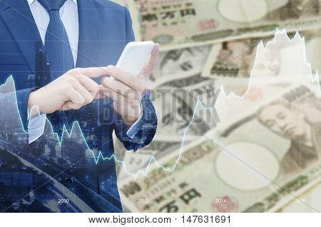 Double Exposure Of Businessman , Financial Graph And Cityscape With Japanese Jpy Yen And Usd Dollar
