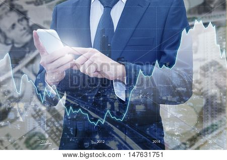 Double Exposure Of Businessman Using Smart Phone, Financial Graph And Cityscape With Japanese Jpy Ye