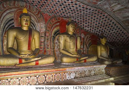 DAMBULLA, SRI LANKA - MARCH 14, 2015: Sculpture of seated Buddha in the ancient Buddhist cave temple. Religious landmark  of the Dambulla, Sri Lanka