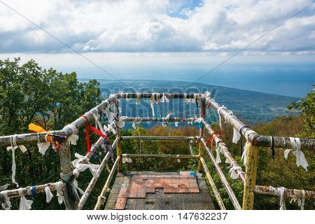 An observation deck at a height of 1005 meters Gagra Abkhazia. Colorful memorial ribbons are tied on the railing.