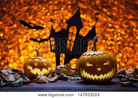 Pumpkin for Halloween, lamp pumpkin, antique wood, bat silhouette, celebrating halloween, smiley on pumpkin, funny and angry, the silhouette of the castle, autumn dry leaves, bright background