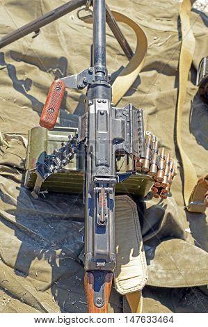 the Russian PK Machine gun Kalashnikov stands on canvas