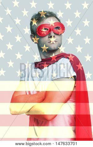 Superhero standing over US flag