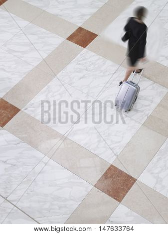 Woman out of focus walking through a lobby