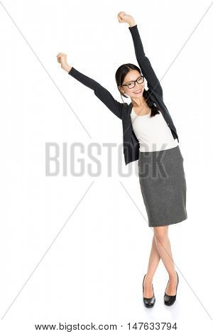 Full length portrait of young Asian female arms outstretched and smiling, isolated on white background.