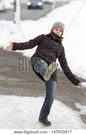 Young Woman Is Slipping And Falling On Street With Black Ice