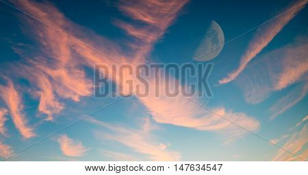 Sunset sky with half moon