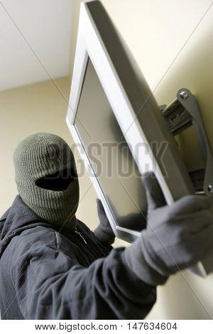 Thief stealing tv