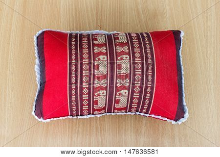 Tradition native Thai style pillow. on wood background