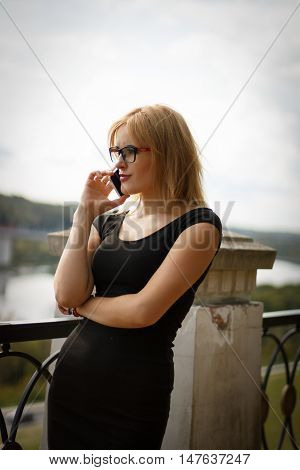 Woman Talking On A Mobile Phone Outdoors