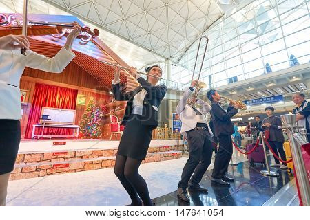 HONG KONG - DECEMBER 24, 2015: Instrumental Flash Mob in Hong Kong Interntational Airport. Hong Kong Interntational Airport is the main airport in Hong Kong.